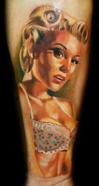 Realistic detailed and colored seductive sexy woman tattoo on arm