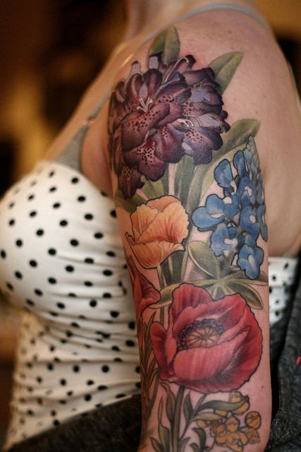 Realistic detailed flowers tattoo on shoulder
