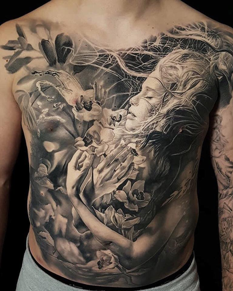 Realistic girl and flowers tattoo on chest