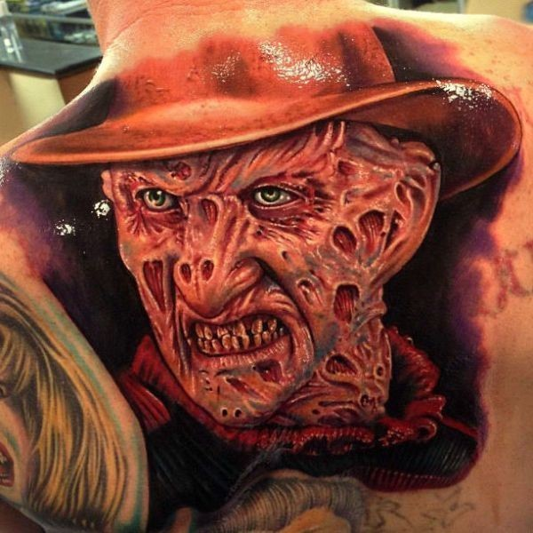Realistic looking back tattoo of Freddy Kruger portrait