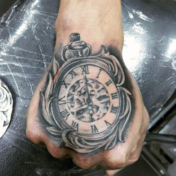 Realistic looking big black and white old pocket clock tattoo on fist