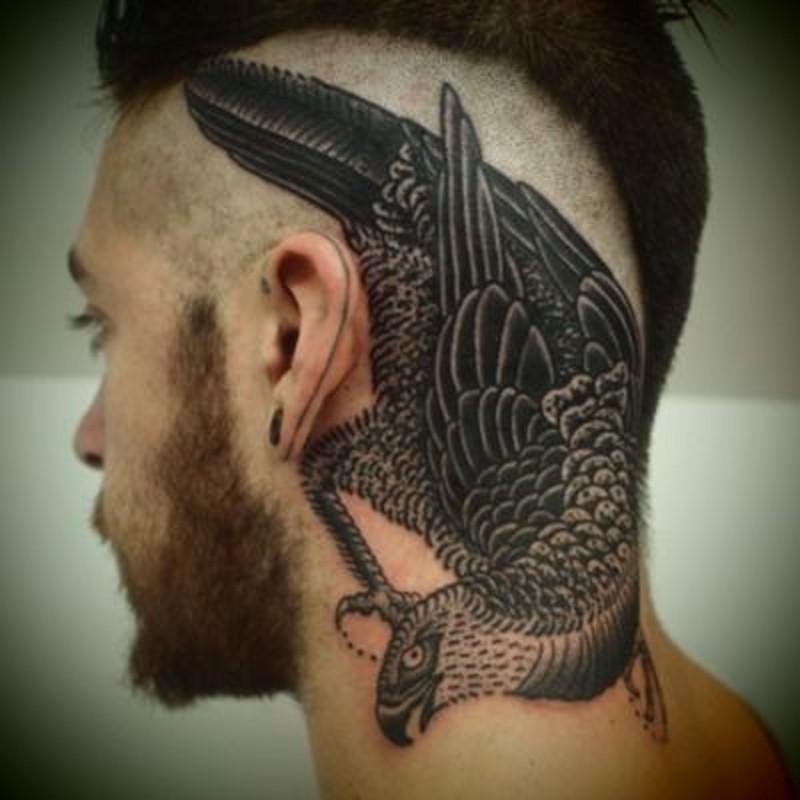 Realistic looking big black ink bird tattoo on head