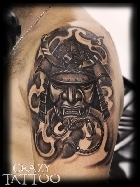 Realistic looking black and gray style shoulder tattoo of samurai mask and fog