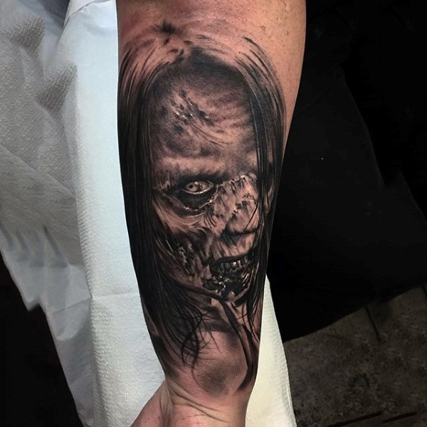 Realistic looking black and white 3D forearm tattoo of monster woman face