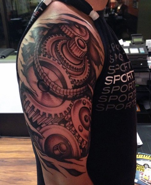 Realistic looking black and white big mechanical tattoo on upper arm