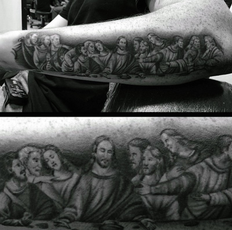 Realistic looking black and white Lord&quots Supper picture tattoo on arm