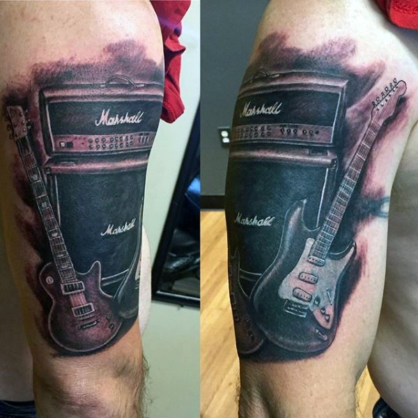 Realistic looking black and white music instruments tattoo on shoulder