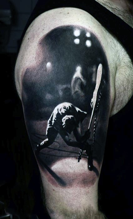 Realistic looking black and white musician with guitar shoulder area tattoo