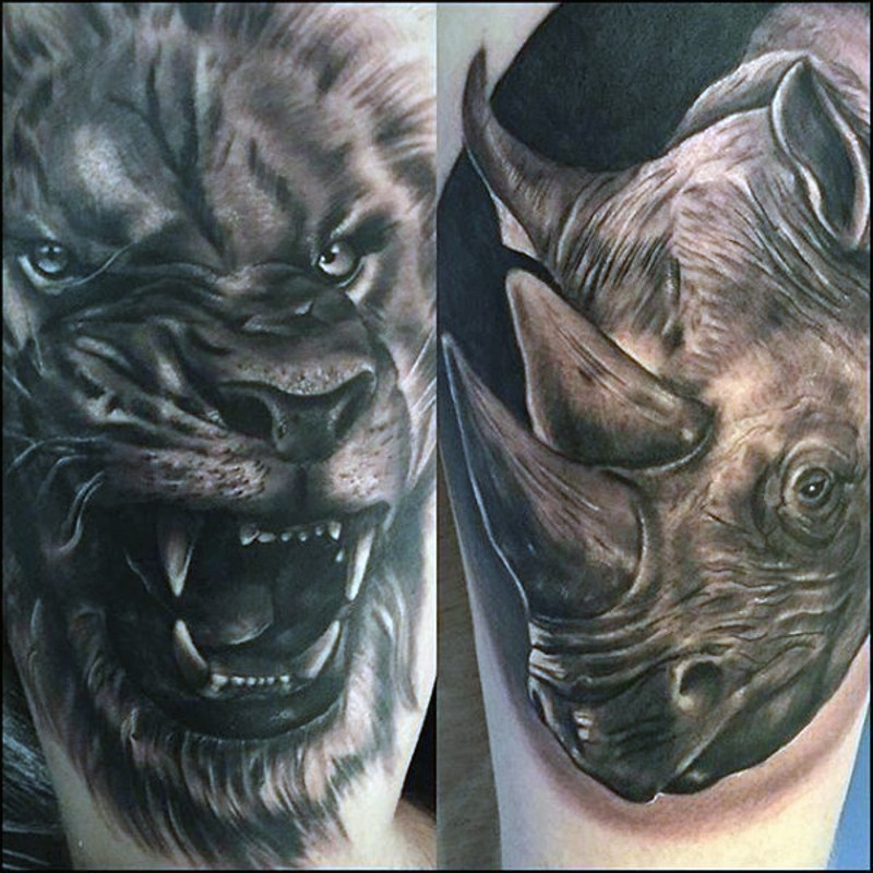 Realistic looking black and white rhino head tattoo combined with roaring lion