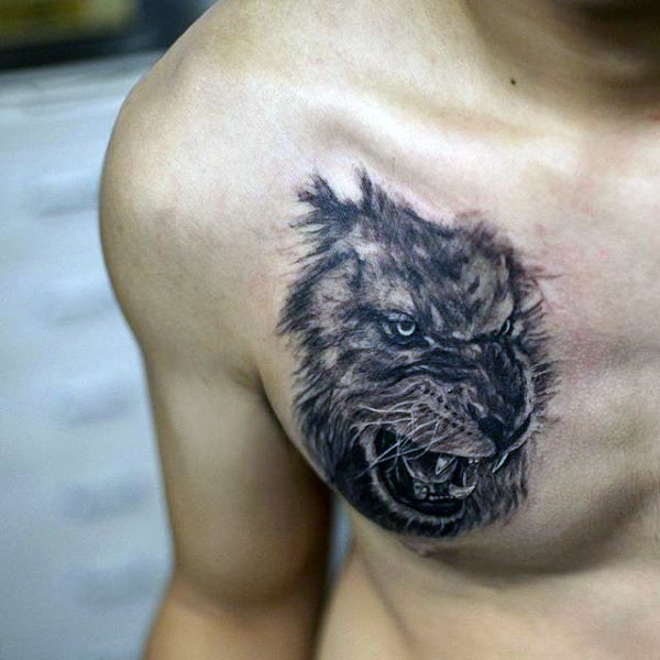 Realistic looking black and white roaring lion tattoo on chest
