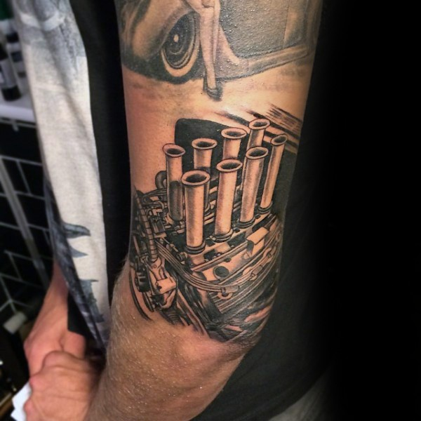 Realistic looking black and white shoulder tattoo of big engine