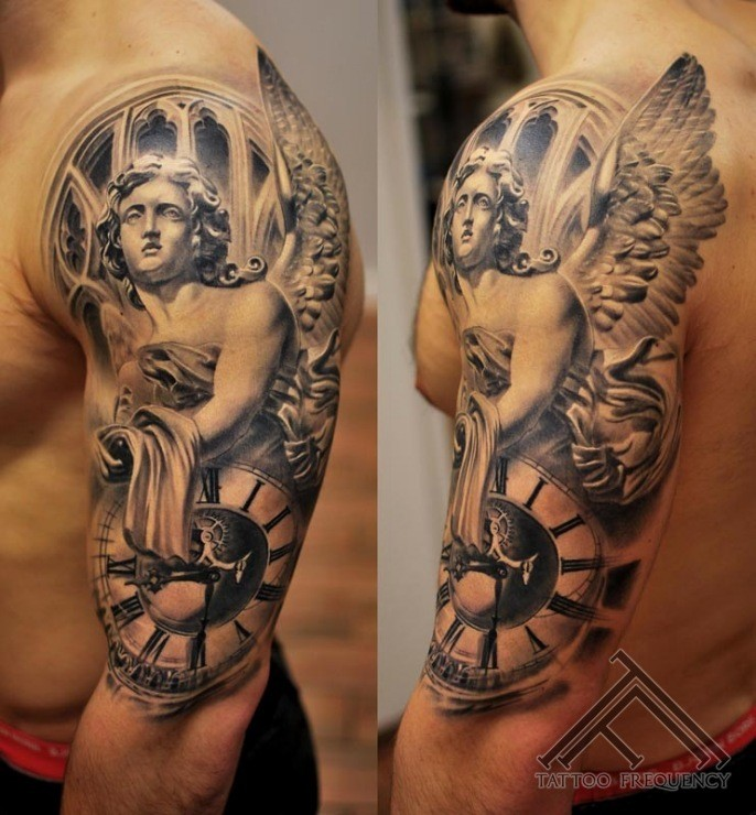 Realistic looking black and white shoulder tattoo of angel statue and clock