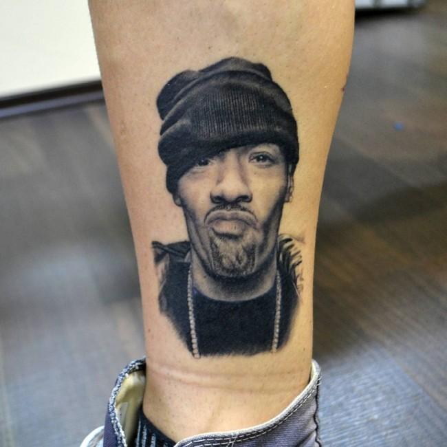 Realistic looking black ink forearm tattoo of man portrait