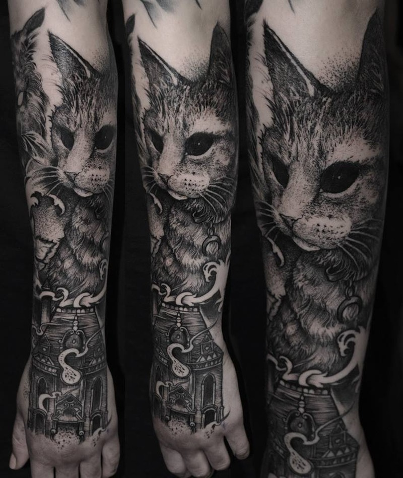 Realistic looking black ink forearm tattoo of cat with old house