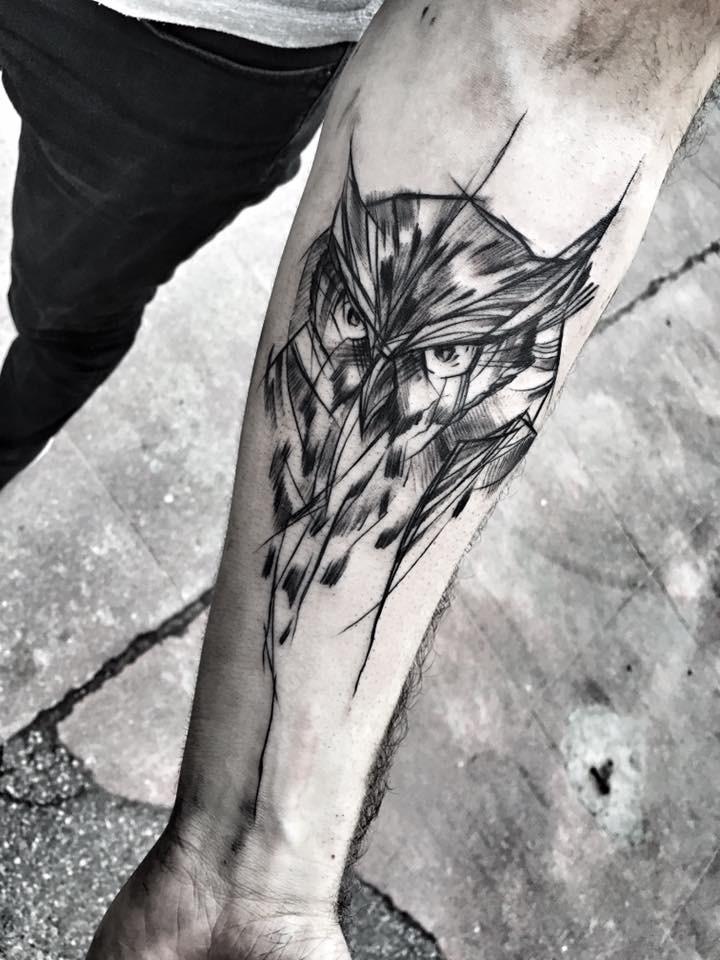 Realistic looking black ink forearm tattoo of owl head by Inez Janiak