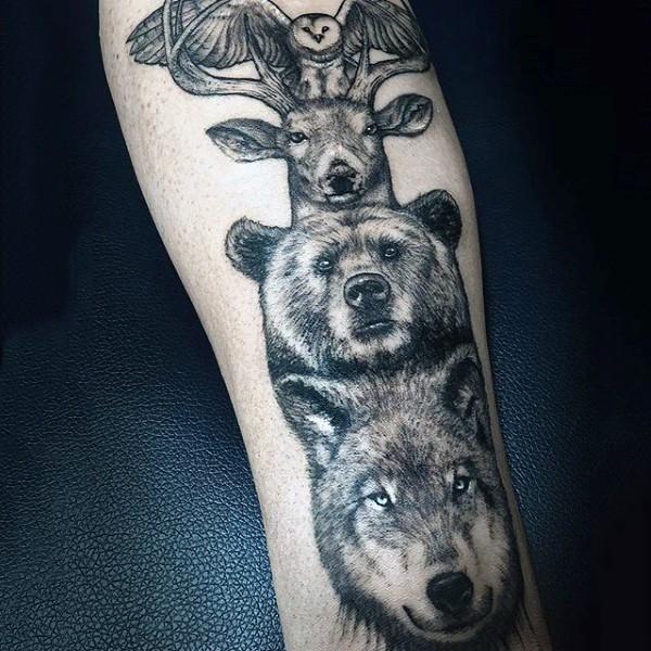 Realistic looking black ink various realistic animals tattoo on sleeve