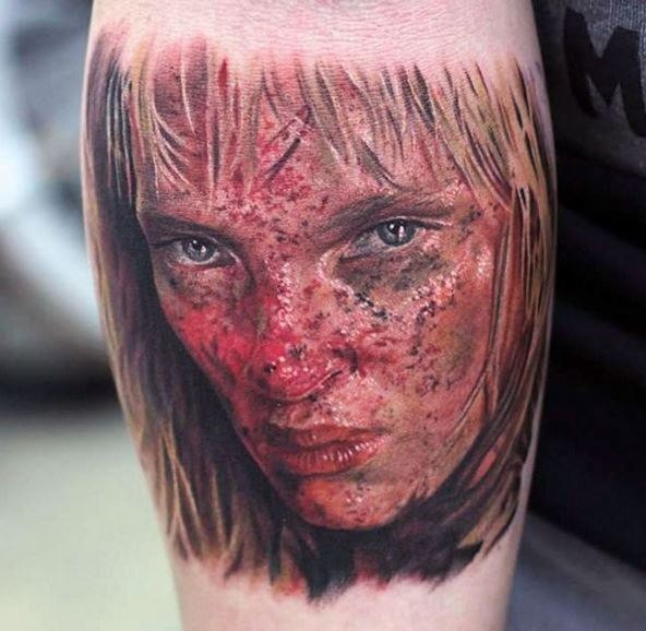 Realistic looking colored arm tattoo of famous actress face