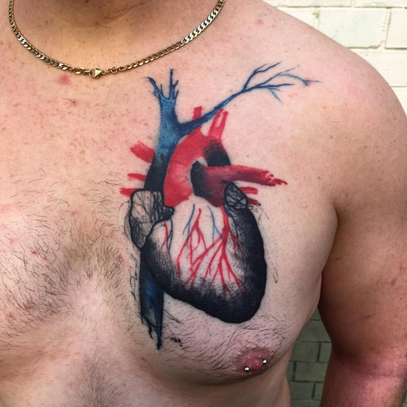 Realistic looking colored chest tattoo of human heart