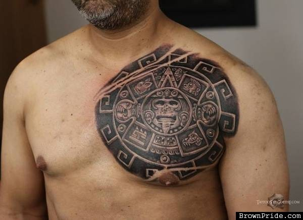 Realistic looking colored chest tattoo of Mayan calendar