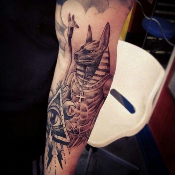 Realistic looking colored forearm tattoo of Egypt God tattoo with mystic eye in triangle