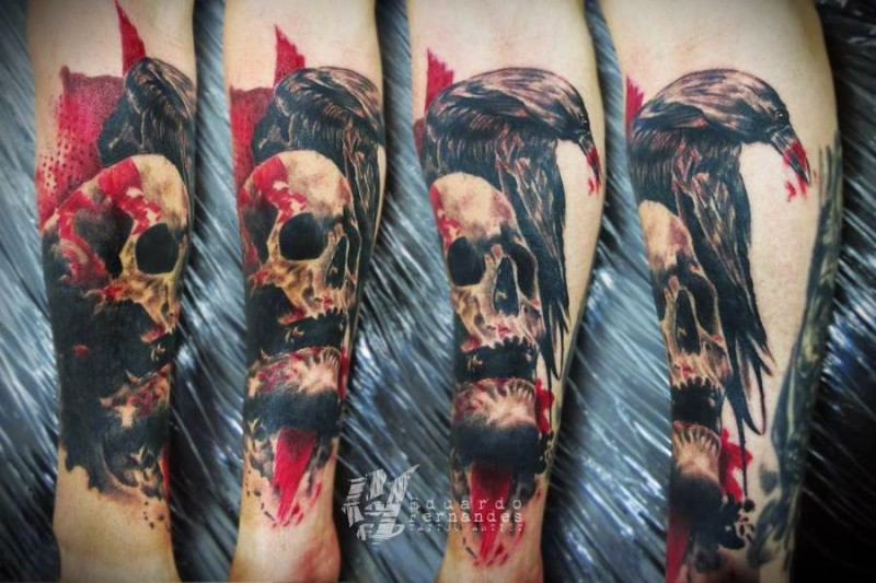 Realistic looking colored forearm tattoo of crow with human skull