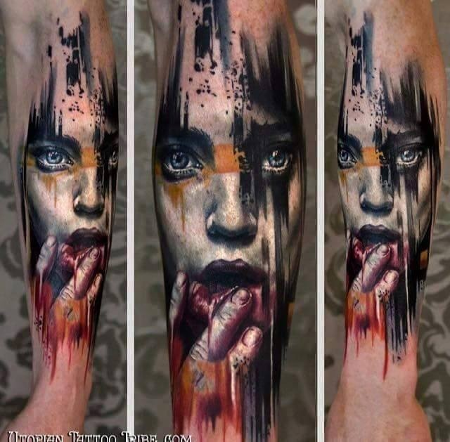 Realistic looking colored forearm tattoo of scary woman