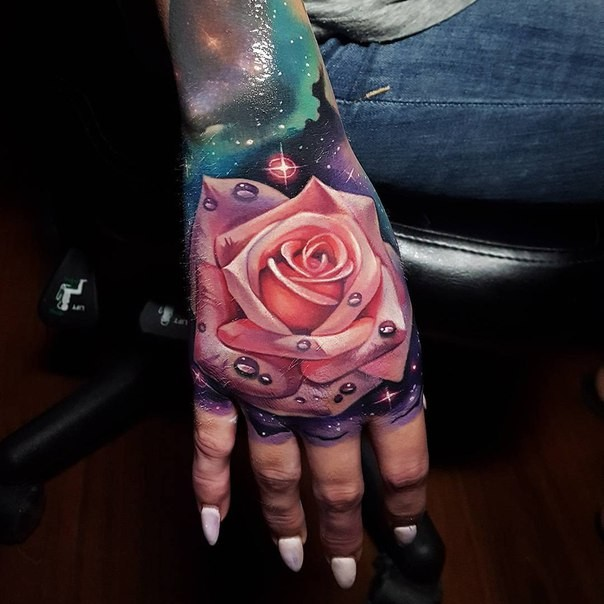 Realistic looking colored hand tattoo of pink rose