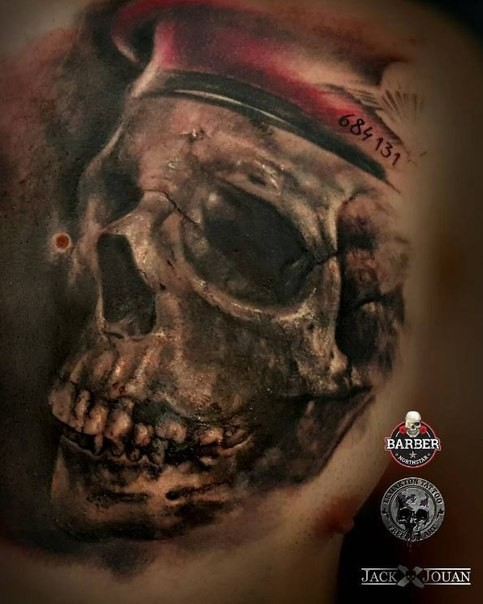Realistic looking colored human skull with hat and number
