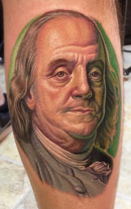 Realistic looking colored leg tattoo of Benjamin Franklin portrait