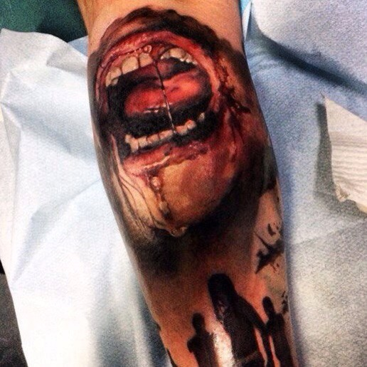 Realistic looking colored leg tattoo of zombie human mouth