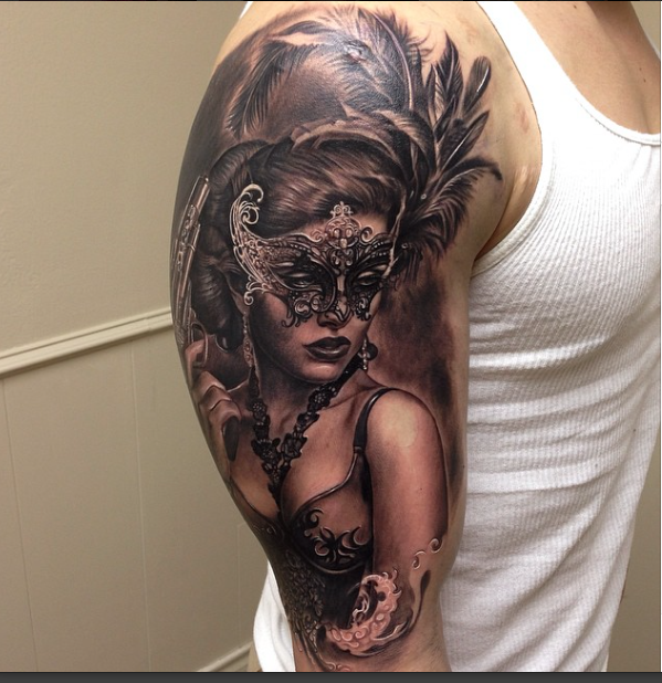 Realistic looking colored shoulder tattoo of seductive woman with mask