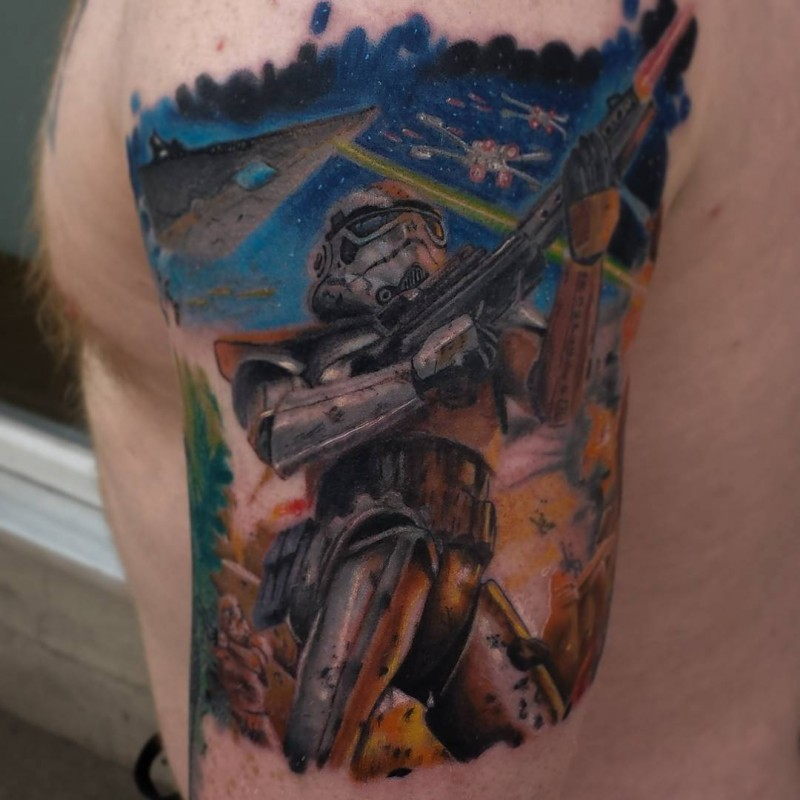 Realistic looking colored shoulder tattoo of Storm trooper with different ships