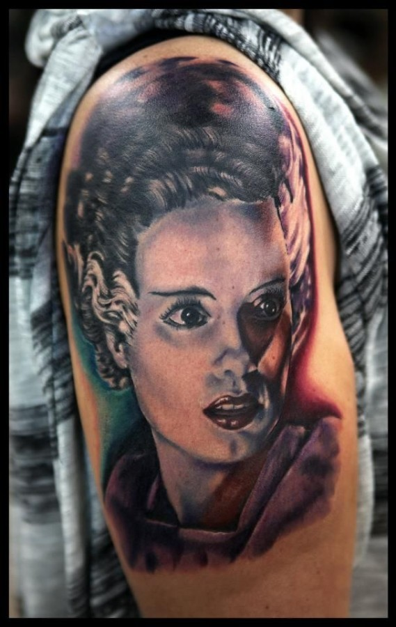 Realistic looking colored shoulder tattoo of vintage woman portrait