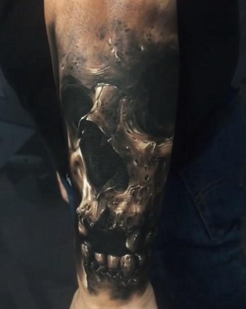 Realistic looking colored tattoo of creepy demon skull
