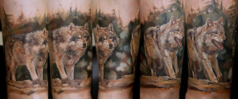 Realistic looking colored tattoo of running wolf