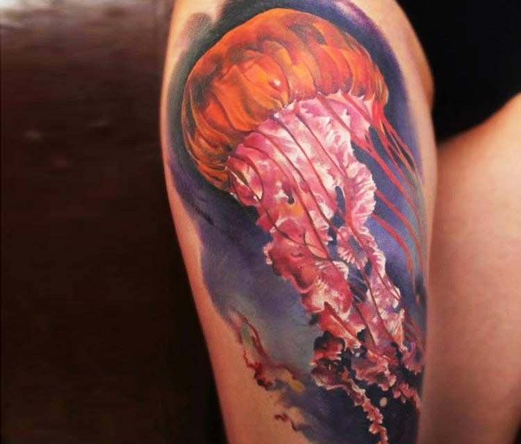 Realistic looking colored thigh tattoo of big jellyfish