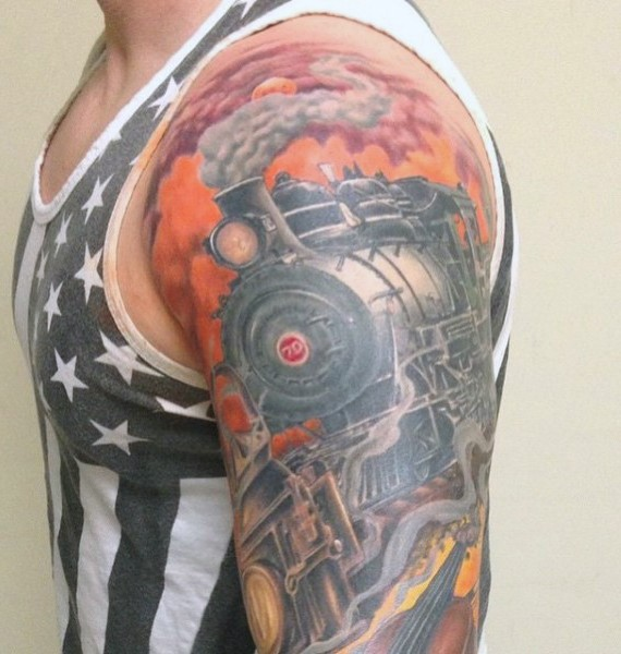Realistic looking colorful old steamy train tattoo on arm