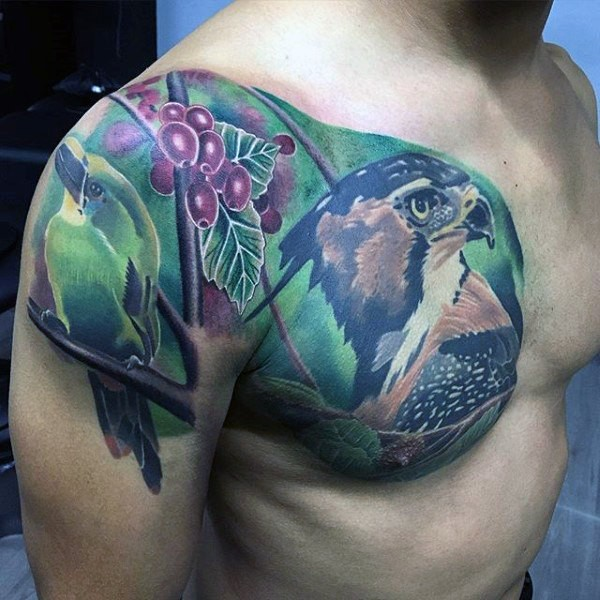 Realistic looking creative painted chest tattoo of eagle with berries