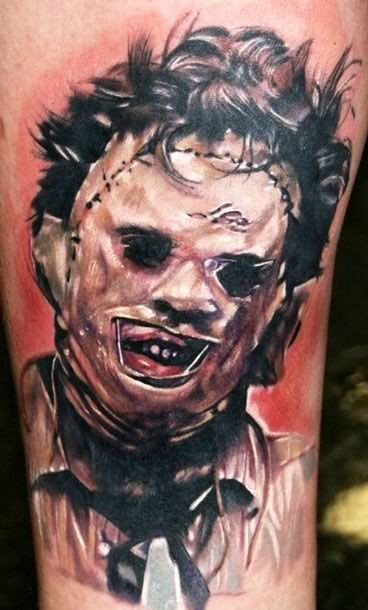 Realistic looking detailed horror movie hero tattoo on thigh