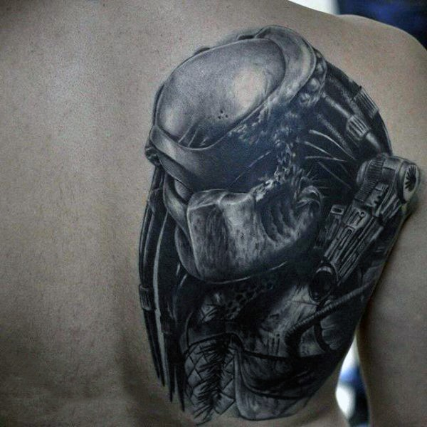 Realistic looking detailed scapular tattoo of evil Predator
