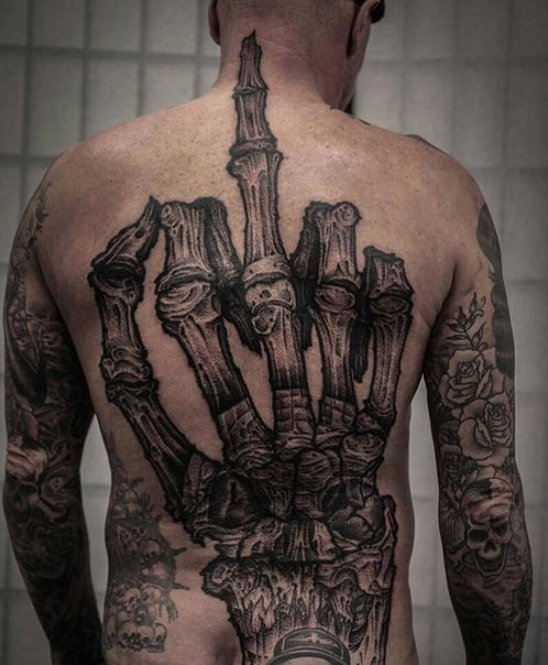 Realistic looking detailed whole back tattoo of skeleton hand
