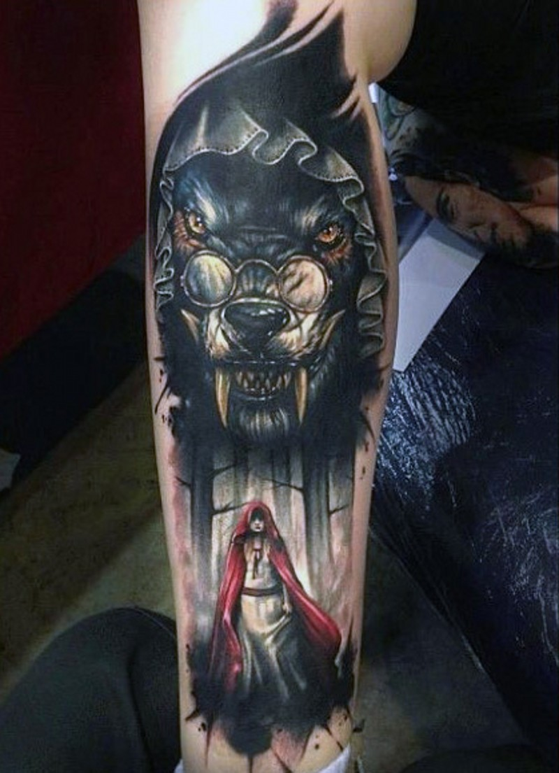 Realistic looking marvelous colored evil witch and wolf tattoo on arm