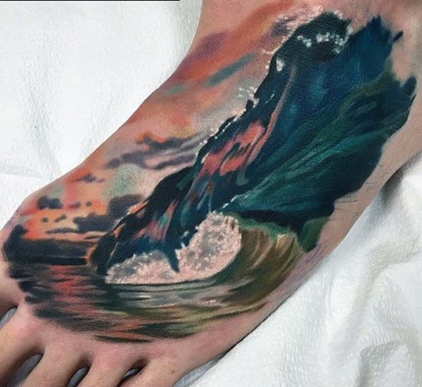 Realistic looking multicolored big ocean wave tattoo on for Wave tattoo on foot