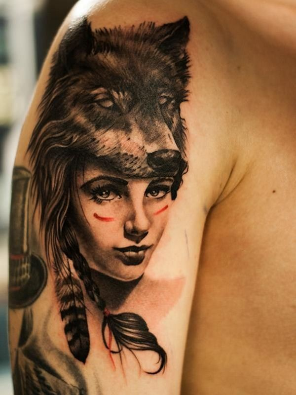 Realistic looking shoulder tattoo of woman with wolf skin