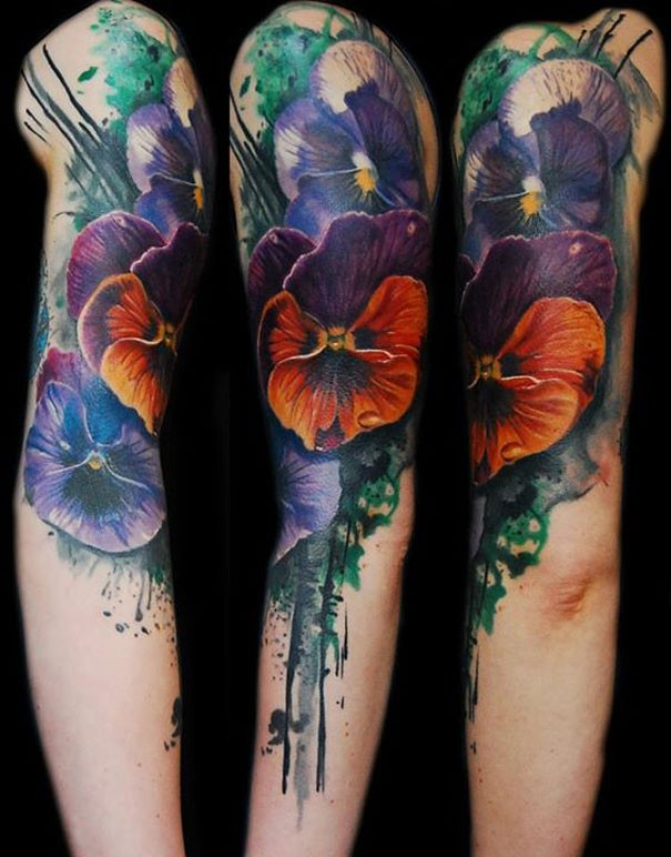 Realistic looking watercolor style shoulder tattoo of various flowers