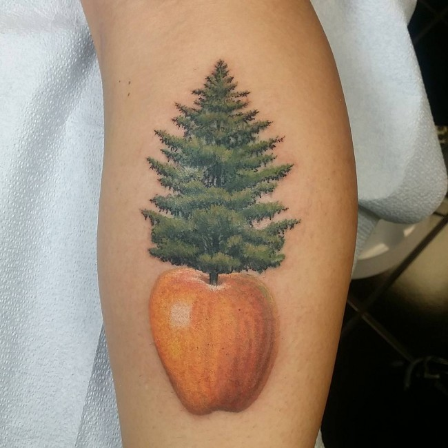Realistic naturally colored pine tree in apple forearm for Realistic tree tattoos