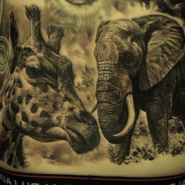 Realistic photo like amazing detailed wild life animals tattoo on waist