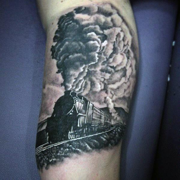 Realistic photo like black and white old steamy train tattoo on leg