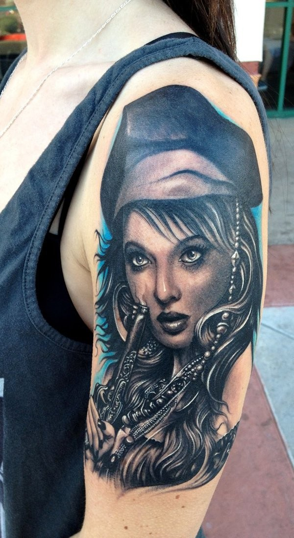 Realistic photo like detailed and colored beautiful woman pirate tattoo on shoulder