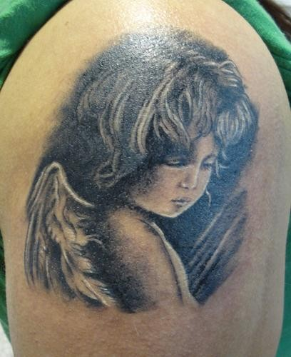 Realistic portrait of cherub girl tattoo